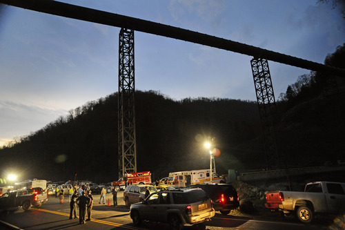 Jeff Gentner  |  Associated Press file photo West Virginia State Police direct traffic at the entrance to Massey Energy's Upper Big Branch Coal Mine in Montcoal, W.Va. on April 5, 2010. An independent investigation concluded the West Virginia coal mine explosion that killed 29 men last year was the result of safety failings by owner Masey Energy Co. and rejects the company's argument that a sudden gas buildup caused the deadliest U.S. coalfield disaster since 1970.