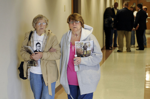 Jeff Gentner  |  Associated Press Joan Mullins, left, the mother of deceased coal miner Rex Mullins, and Sherry Mullins Scurlock, his sister, leave a briefing with families Thursday in Beckley, W.Va. Families connected to the Upper Big Branch mine explosion that killed 29 coal miners on April 5, 2010 met with mine investigators.