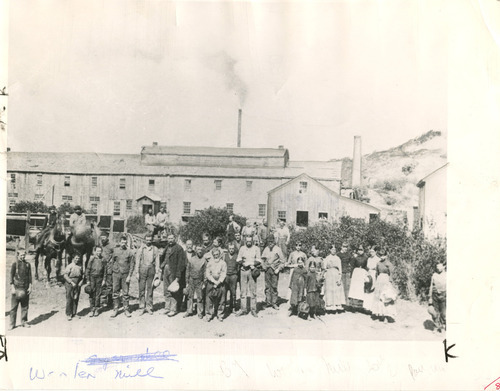 File photo | The Salt Lake Tribune  A group of people are gathered outside the sugar mill after which Sugar House was named. Oddly, sugar was never produced in the mill but it was used as a paper mill and woolen mill, among other things.