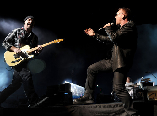 The Edge and Bono of the band U2 perform at Rose Bowl during their U2 360 Tour on October 25, 2009 in Pasadena, California.  (Photo by Kevin Mazur/WireImage)