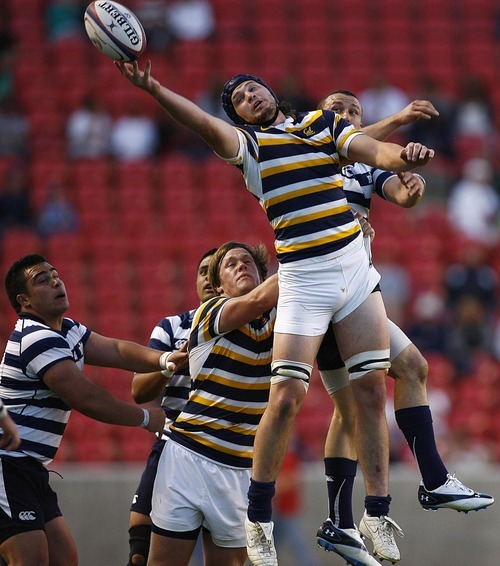 Djamila Grossman     The Salt Lake Tribune  California's Daniel Barrett (8) tries to catch the ball in a game against Brigham Young University in the National College Rugby Championship game at Rio Tinto Stadium in Sandy, Utah, on Saturday, May 21, 2011.