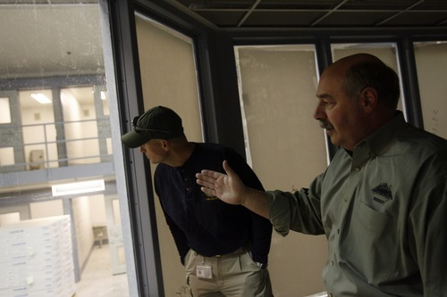 Chris Detrick  |  Tribune file photo  Utah County Sheriff Jim Tracy, right, and Lt. Neal Castleberry in Dec. 2007 show the Special Housing Unit that was then under construction at the jail in Spanish Fork.