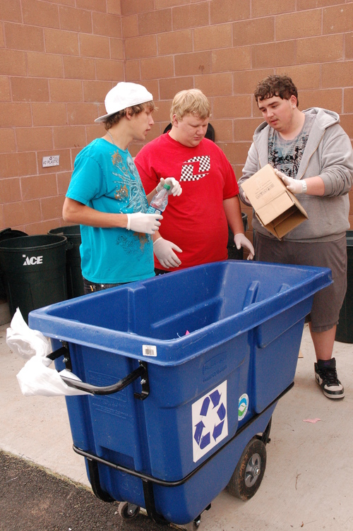 TOM HARADEN  |  Special to The Salt Lake Tribune Terry Longden, Colby Burgess, and Kyle Yost sort recycling as part of Mary Walker-Irvin's ecology class at Grand County High School in Moab.
