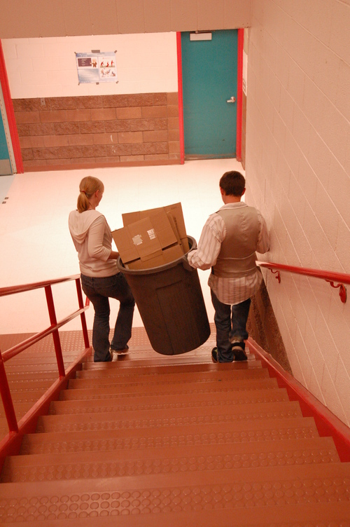 TOM HARADEN  |  Special to The Salt Lake Tribune Tanika Lewis and Randy Treptow carry recycling to be sorted as part of Mary Walker-Irvin's ecology class at Grand County High School in Moab.