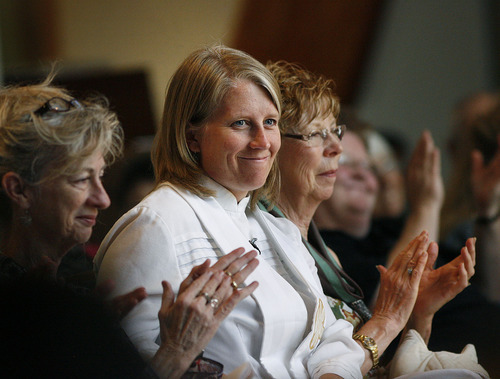 Scott Sommerdorf  |  The Salt Lake Tribune Erin Gilmore, pastor of Holladay United Church of Christ, sits in the pews prior to addressing the congregation about