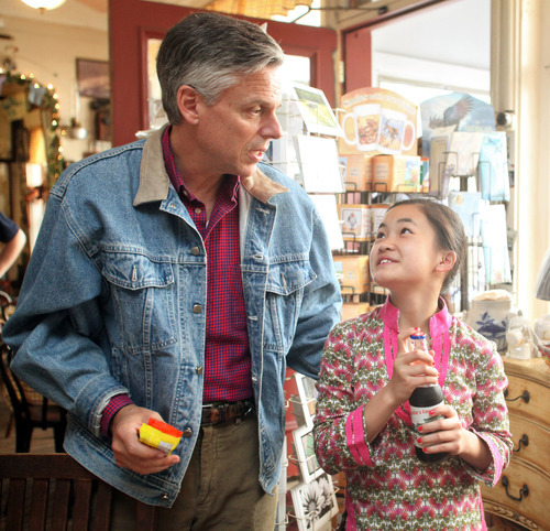 Max Bittle, special to The Salt Lake Tribune Former Utah Gov. Jon Huntsman Jr. talks with his daughter Gracie Mei at Robie's Country Store in Hooksett, N.H., on Saturday.