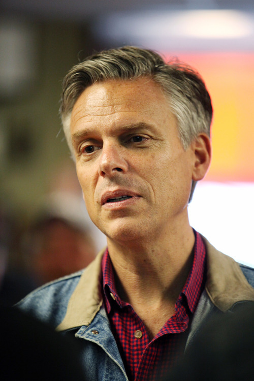 Max Bittle, special to The Salt Lake Tribune Former Utah Gov. Jon Huntsman Jr. talks with staff members of Manchester Harley-Davidson while visiting the shop in Manchester, N.H., on Saturday.