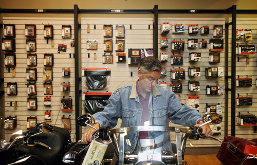 Max Bittle, special to The Salt Lake Tribune Former Utah Gov. Jon Huntsman Jr. sits on a motorcycle at Manchester Harley-Davidson while visiting the shop in Manchester, N.H., on Saturday.