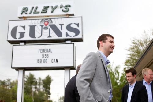 Max Bittle, special to The Salt Lake Tribune Staffers with former Utah Gov. Jon Huntsman Jr. wait for him to arrive at Riley's Gun Shop in Hooksett, N.H., on Saturday.