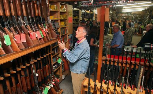 Max Bittle, special to The Salt Lake Tribune Former Utah Gov. Jon Huntsman Jr. looks at a gun at Riley's Gun Shop in Hooksett, N.H., on Saturday.