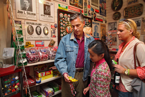 Max Bittle, special to The Salt Lake Tribune Former Utah Gov. Jon Huntsman Jr., a possible 2012 presidential candidate, looks at candy with daughters Gracie Mei and Elizabeth at Robie's Country Store in Hooksett, N.H., on Saturday.