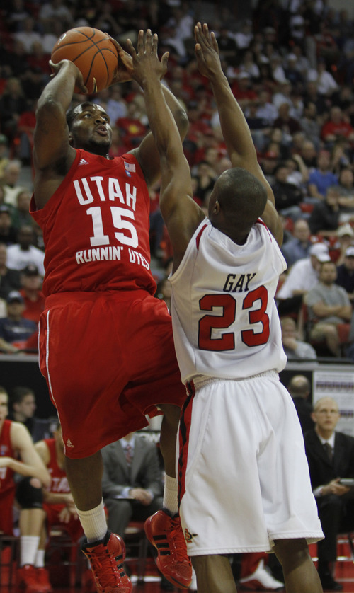 Rick Egan  | Salt Lake Tribune  Utah guard Josh Watkins (15) shoots over San Diego State guard D.J. Gay (23) in basketball action, Utah vs. San Diego State, in the Mountain West Conference Championships in Las Vegas, Thursday, March 10, 2011