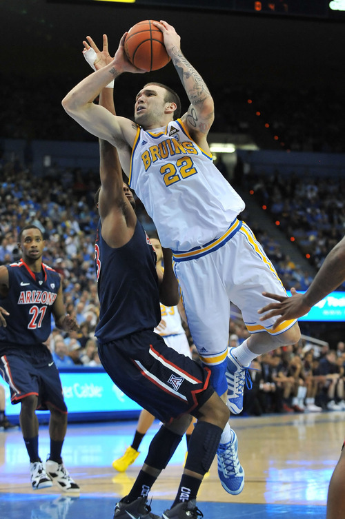 Associated Press UCLA Bruins forward Reeves Nelson goes up for the score past the Arizona Wildcats forward Derrick Williams at the last home game before major renovations at Pauley Pavillion on Feb. 26, 2011 in Los Angeles.