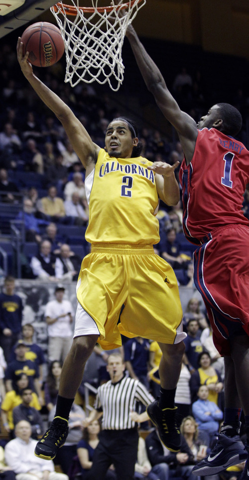 Associated Press California 's Jorge Gutierrez (2) shoots past Mississippi's Terrance Henry (1) during the second half of a first-round NIT college basketball tournament game in Berkeley, Calif., March 16, 2011.