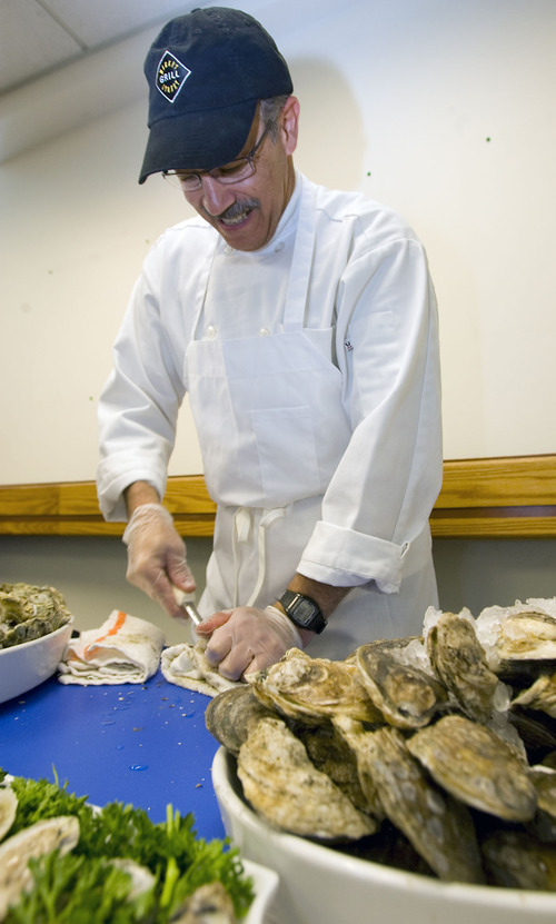 Al Hartmann     The Salt Lake Tribune Bruce Becker, a chef at Market Street Grill, shucks fresh Blue Point oysters on Tuesday that will be offered at their new restaurant at Salt Lake City International Airport. Officials showcased food samplings from several Salt Lake restaurants that will be opening outlets at the airport.