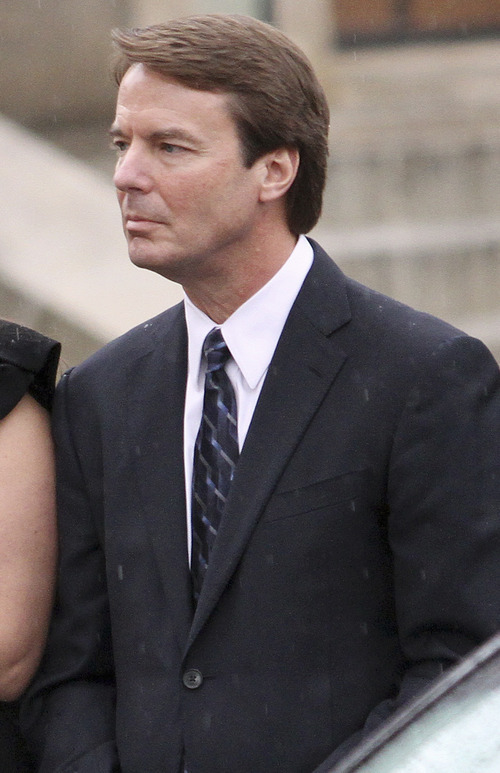 In this Dec. 11, 2010 file photo, Former Democratic presidential candidate John Edwards is seen in Raleigh, N.C. A person familiar with a federal investigation into Edwards' political dealings says prosecutors have completed their probe of the two-time presidential candidate and could indict him within days.  (AP Photo/Jim R. Bounds, File)