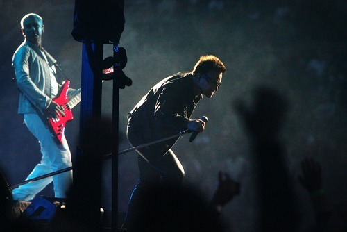 Steve Griffin  |  The Salt Lake Tribune  Bono sings to a screaming crowd as Adam Clayton plays bass during the U2 360 Tour concert at Rice Eccles Stadium in Salt Lake City on Tuesday, May 24, 2011.