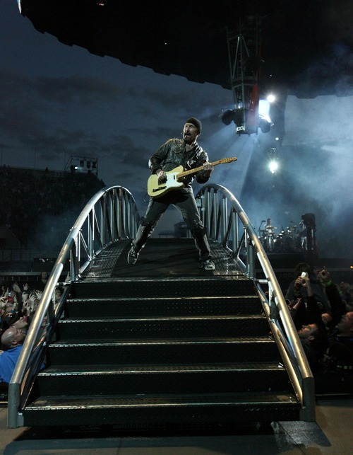 Steve Griffin  |  The Salt Lake Tribune  The Edge plays his guitar as we walks across a bridge during the U2 360 Tour concert at Rice Eccles Stadium in Salt Lake City on Tuesday, May 24, 2011.