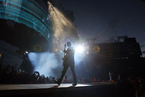 Steve Griffin  |  The Salt Lake Tribune  The Edge plays his guitar as we walks on stage during the U2 360 Tour concert at Rice Eccles Stadium in Salt Lake City, Utah Tuesday, May 24, 2011.