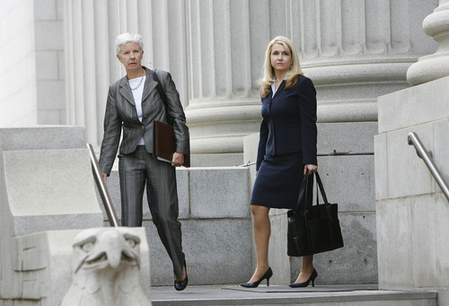 Francisco Kjolseth  |  The Salt Lake Tribune  Carlie Christensen, U.S. attorney for Utah, and prosecutor Diana Hagen leave court after Brian David Mitchell received a life sentence Wednesday, May 25, 2011.