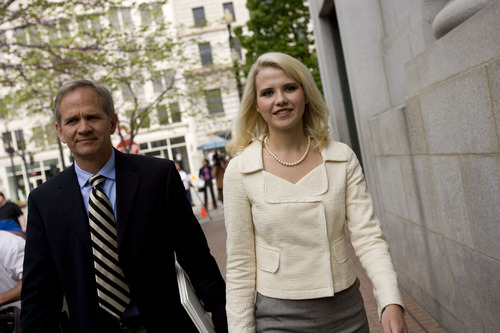 Djamila Grossman  |  The Salt Lake Tribune  Elizabeth Smart and Ed Smart leave court after Brian David Mitchell received a life sentence Wednesday, May 25, 2011.