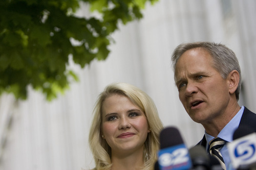 Djamila Grossman  |  The Salt Lake Tribune  Elizabeth Smart and Ed Smart speak to the media after Brian David Mitchell received a life sentence Wednesday, May 25, 2011.