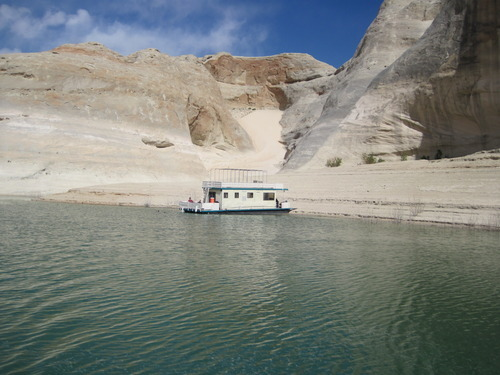 Tom Wharton  |  The Salt Lake Tribune Taking a houseboat to a beach or a sand dune at Lake Powell is a popular activity.