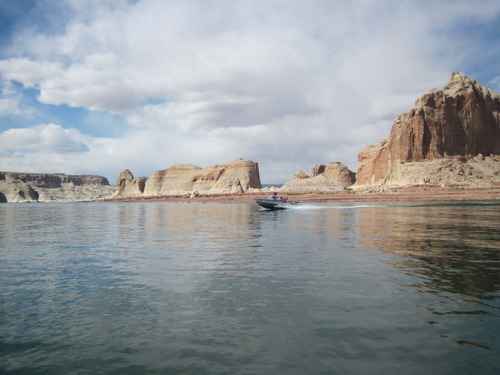 Tom Wharton  |  The Salt Lake Tribune A powerboat skims across the blue waters of Lake Powell.