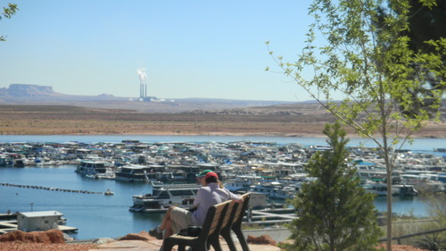 Tom Wharton  |  The Salt Lake Tribune Tourists enjoy their time at Wahweap Marina with the Navajo Power Plant in the background.