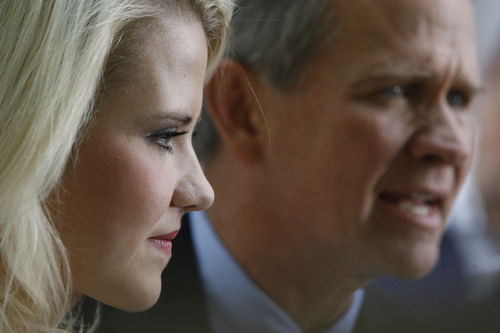 Francisco Kjolseth  |  The Salt Lake Tribune  Elizabeth Smart and her father Ed speak to the media after Brian David Mitchell received a life sentence Wednesday, May 25, 2011.