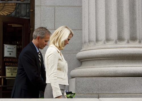 Trent Nelson  |  The Salt Lake Tribune Ed and Elizabeth Smart exit the Frank E. Moss Courthouse in Salt Lake City on Wednesday, May 25, 2011, after Brian David Mitchell was sentenced to life in prison for his role in the kidnapping of Elizabeth Smart.