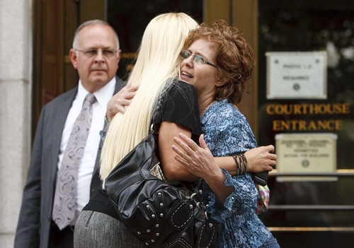 Trent Nelson  |  The Salt Lake Tribune Rebecca Woodridge, left, stepdaughter of Brian David Mitchell, embraces a woman Wednesday after Mitchell was sentenced to life in prison for his role in the kidnapping of Elizabeth Smart.