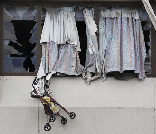 A walker hangs out a window blown out by a tornado at St. John's Regional Health Center on Thursday, May 26, 2011, in Joplin, Mo. A tornado tore through much of the city Sunday, wiping out neighborhoods and killing at least 125 people. (AP Photo/Mark Humphrey)