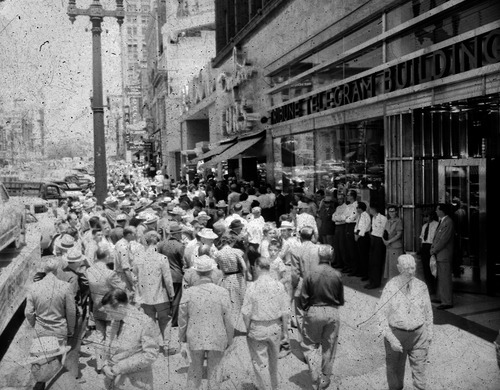 File photo   The Salt Lake Tribune   People gather outside the Tribune Telegram building in 1950 to get news on the Korean War.