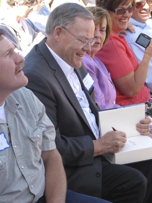 Mark Havnes    The Salt Lake Tribune Author Gerald Lund autographs his book