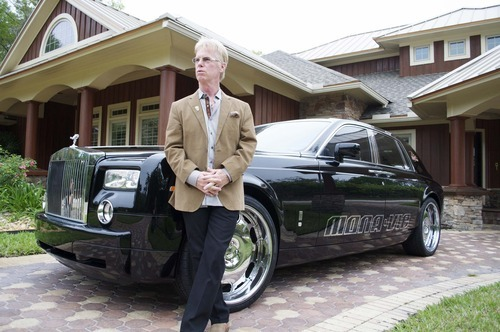 Brig Hart, the top distributor at MonaVie, poses with his Rolls Royce. Hart is likely the top-earning multilevel marketer in the world, at one time earning more than $600,000 a month. Courtesy image.
