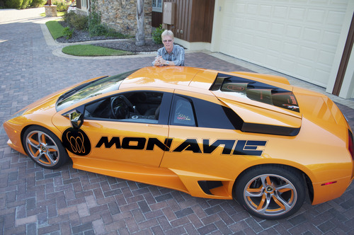 Brig Hart, the top distributor at MonaVie, poses with his Lamborghini. Hart is likely the top-earning multilevel marketer in the world, at one time earning more than $600,000 a month. Courtesy image.