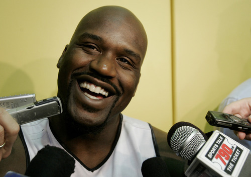 This April 19, 2007, file photo shows Miami Heat center Shaquille O'Neal talking to the news media following a team basketball practice in Miami.  O'Neal says on Twitter that he's