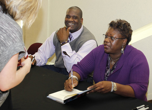 This March 31, 2010 file photo shows Cleveland Cavaliers center Shaquille O'Neal and his mother, Lucille O'Neal, signing copies of her book,