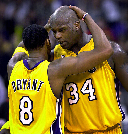 This April 21, 2002 file photo shows Los Angeles Lakers's Kobe Bryant, left, and Shaquille O'Neal embracing in the closing minutes in Game 1 of their best-of-five first-round Western Conference playoff series against the Portland Trail Blazers in Los Angeles.  O'Neal says on Twitter  Wednesday June 1, 2011,that he's
