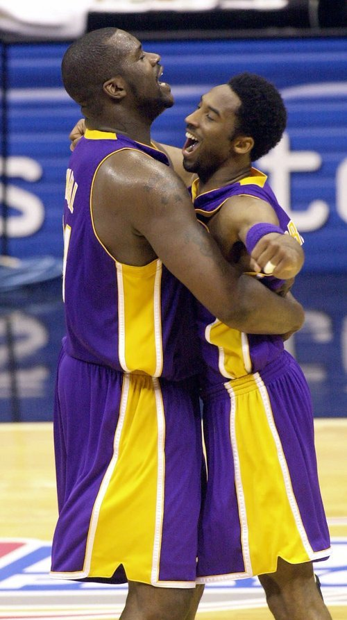 This May 21, 2001 file photo shows Los Angeles Lakers center Shaquille O'Neal, left, and teammate Kobe Bryant embracing at mid court during the final second of their victory over the  San Antonio Spurs in game two of the Western Conference Finals in San Antonio, Texas, Monday, May 21, 2001. O'Neal says Wednesday June 1, 2011, on Twitter that he's