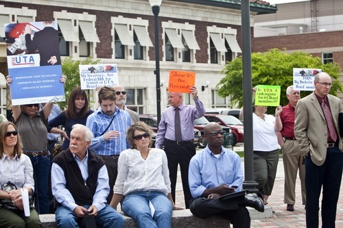 Chris Detrick     The Salt Lake Tribune  Utah Transit Authority protesters show up Wednesday at the kickoff event Wednesay for a strategic regional planning effort. The protesters held up signs criticizing the transit agency for high executive salaries and conflicts of interest.