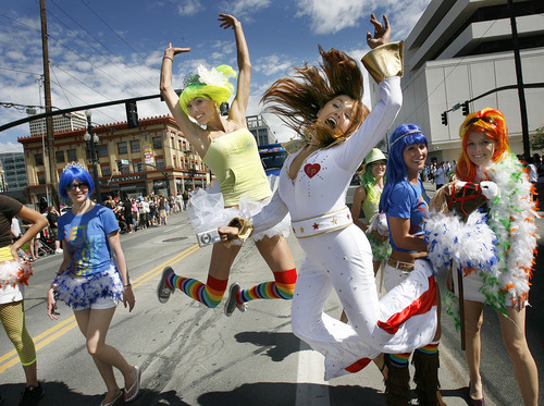 Scott Sommerdorf     The Salt Lake Tribune Bud Girls Paris Gibson, left, and Beverly Stachowiak jump as their float makes its way along the route on June 6, 2010.