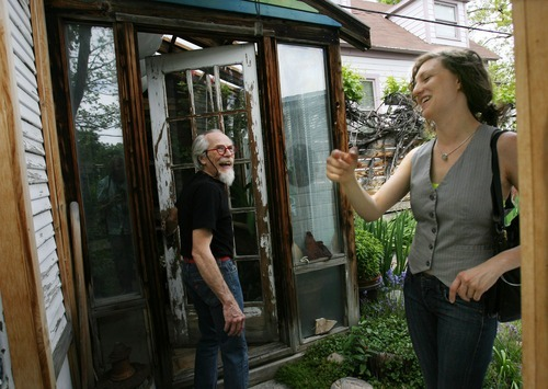 Steve Griffin  |  The Salt Lake Tribune  Artist Jim Williams, left,  in his Salt Lake City home Wednesday, June 1, 2011. Williams has been installing his art work in his home for years.  Cara Despain, right, is curating an exhibition about the house.