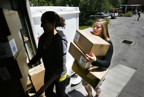 Scott Sommerdorf  |  The Salt Lake Tribune Cara Cerise, helps load boxes of supplies for the upcoming Pride Parade at the Pride Center, Thursday, June 2, 2011. Cerise, 20, has been named the 2011 Utah Young Humanitarian. The $5,000 scholarship is funded by the George S. & Dolores Dore Eccles Foundation to recognize youths who give back to the community. Cerise is a longtime volunteer who sits on the board of directors of the Inclusion Center and works regularly with the Utah Pride Center.