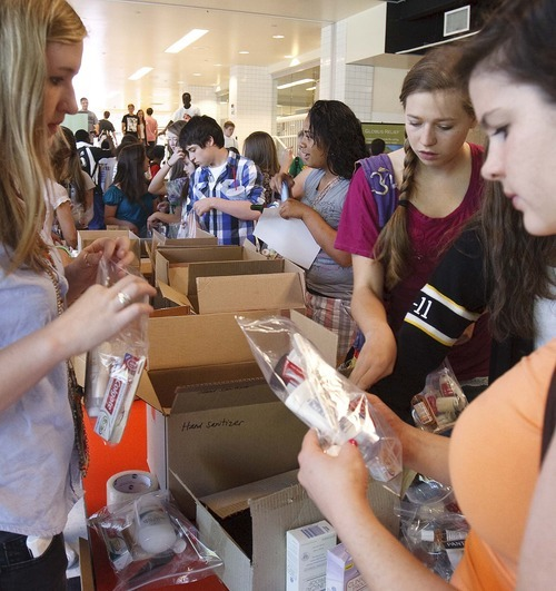 Trent Nelson  |  The Salt Lake Tribune Students at Highland High School in Salt Lake City participated in a day of service Tuesday, June 7, 2011, assembling hygiene kits and writing letters to soldiers, among other activities.