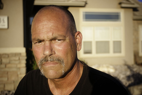 COBB CONDIE/Special to the Tribune    Dennis Pizzo stands in front of his home in Washington Tuesday May, 31 2011.  Pizzo is trying to apply for Social Security Disability Insurance, but due to budget restraints, he can no longer go to a hearing site in Southern Utah.