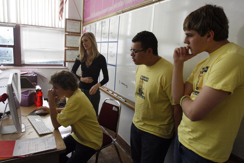 Rick Egan   |  The Salt Lake Tribune Grant Amman, left, Courtney Hansen, Leki Mahe and C.J. Hellige, look at the Web page they designed at Midvale Middle School. Eleven of Courtney Hansen's students are going on to the National History Day event in Maryland.