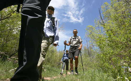 Steve Griffin  |  The Salt Lake Tribune After a years-long effort, Utah Open Lands recently dedicated the high-mountain Killyon Canyon preserve as public space. Terry Crandall, left, hikes with Ella and John Kortbawi along the Killyon Canyon trail, along with the Kortbawi's children and dogs.