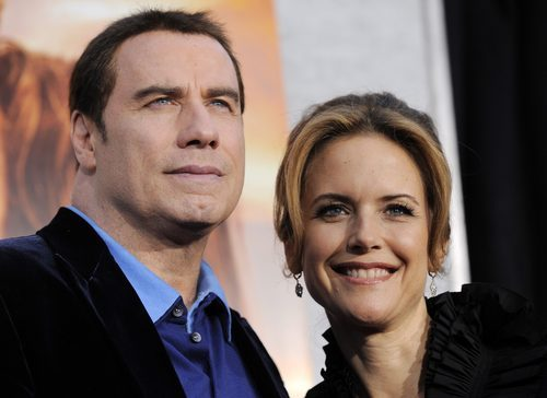Chris Pizzello  |  AP file photo Actor John Travolta and his wife, Kelly Preston.
